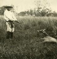 Man with deer specimen