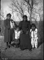 Sioux woman & 3 children, outdoors