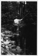 Unidentified man fishing in mountain stream