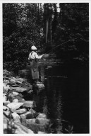 Unidentified woman fishing in mountain stream