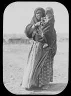Native American woman holding child