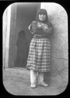 Native American woman in front of doorway