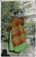 Jicarilla Apache Grandmother carrying grandchild, Apache way