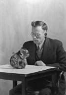 H.H. Nininger studying specimen