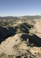 Dr. Kirk Johnson prospecting for a dig site on the Kaiparowits Plateau.