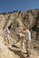 L-R: DMNS Volunteer David Allen, DMNS Volunteer Dane Miller and Dr. Ian Miller use picks to reveal the secrets of a dig site on the Kaiparowits Plateau.