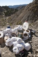 Specimens wrapped in toilet paper await transport to the camp along with some of the tools of the trade on the Kaiparowits Plateau.