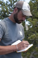 Dr. Joseph Sertich, DMNS Curator of Vertebrate Paleontology, makes careful notes in his field journal.