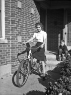 Unidentified Girl on a Bicycle
