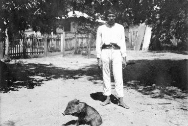 Young man and peccary
