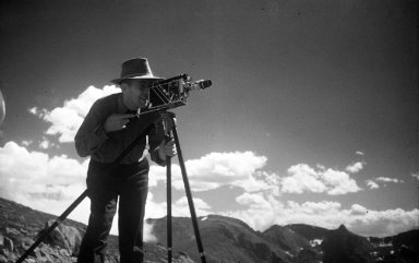 Alfred M. Bailey with motion picture camera