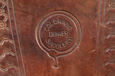 "Close up of the embossed stamp on the saddle from ""Colorado Saddlery Denver""."