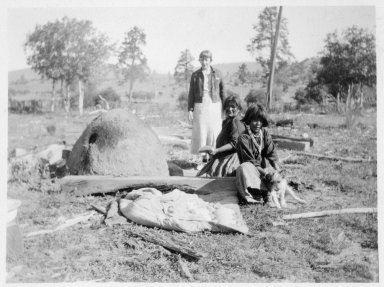Jicarilla Apache women baking bread