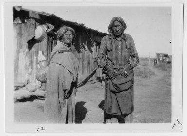 Jicarilla Apache couple bringing home water