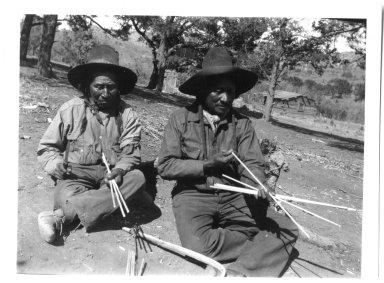 Jicarilla Apache men making bows and arrows