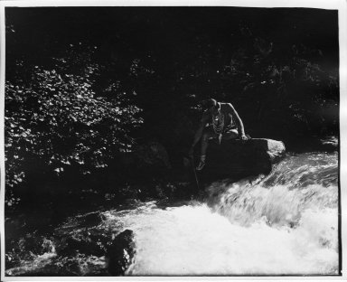Northern Plains man fishing in stream