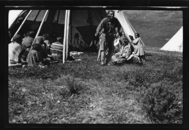 Men and women in a tipi