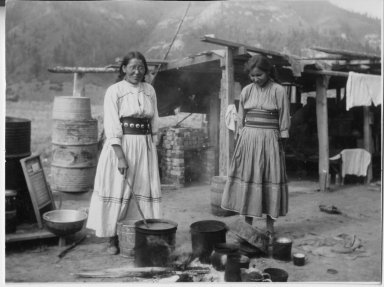 Jennie and her sister, Hazel Veneno, cooking outdoors.
