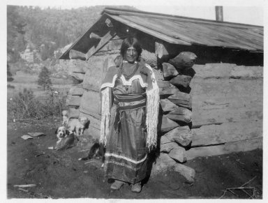 Juan Chiquito, a San Ildefonso Pueblo man married into the Apache Tribe, dressed in a woman's old beaded yoke and cloth dress.