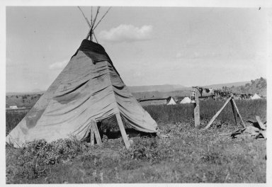 Camp scene: Tipi and drying meat.