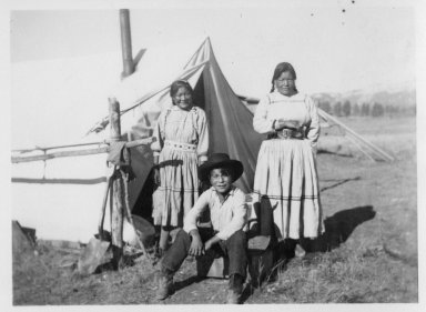Velarde family members by a tent.