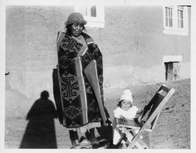Petklo Garcia, wrapped in a Pendleton blanket, and child, Dorothy.