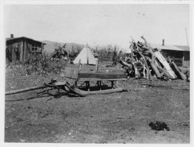 Camp scene: House, tipi and handmade box and sled