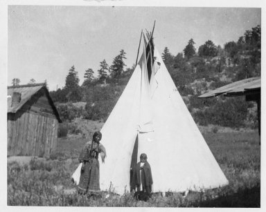 Camp: Woman, child and tipi