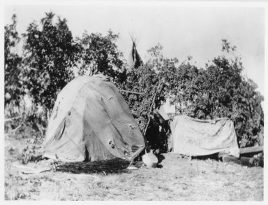 Brush Arbor Shelter covered with tarp