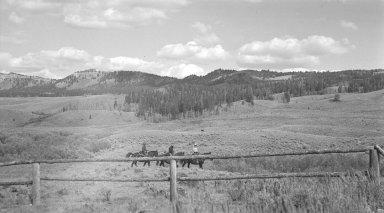 Horseback riders (possibly landowners)