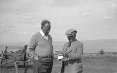 Mr. Leonard (right) and unidentified man