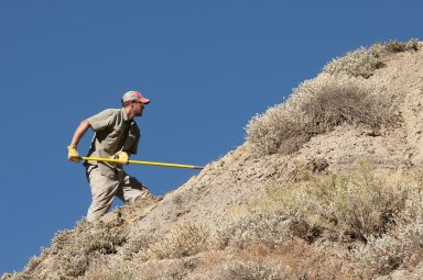 DMNS Volunteer Dane Miller works on a dig site in the Kaiparowits Plateau.