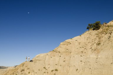 L-R: DMNS Volunteers Dane Miller and David Allen look up from an excavation site on the Kaiparowits Plateau.