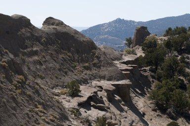 Rock shelves and hoodoos near the top of a ridgeline on the Kaiparowits Plateau.