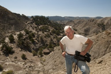 Dave Baysinger poses holding his video camera on the Kaiparowits Plateau.