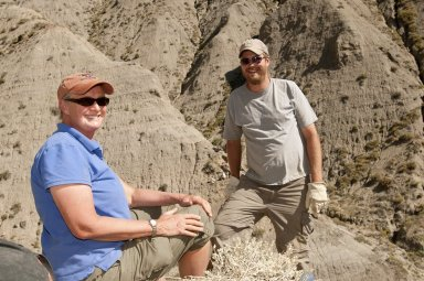 DMNS Volunteer Sue Miller and Dr. Ian Miller pose near a dig site on the Kaiparowits Plateau.