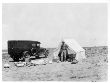 Man in front of tent, Horsetail Creek excavation