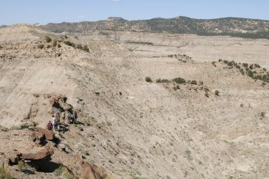 The DMNS group hikes along a trail on a ridgeline in the Kaiparowits Plateau.