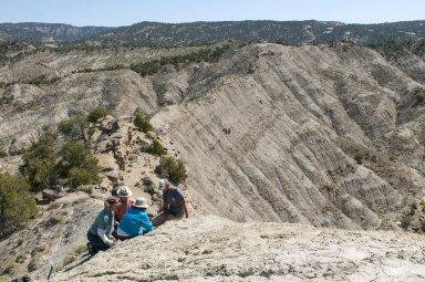 A DMNS Team examines a potential dig site in the Kaiparowits Plateau.