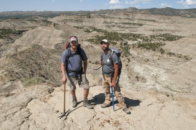 Dr. Ian Miller (L) and Dr. Joseph Sertich(R) pose with the Kaiparowits Plateau in the background.
