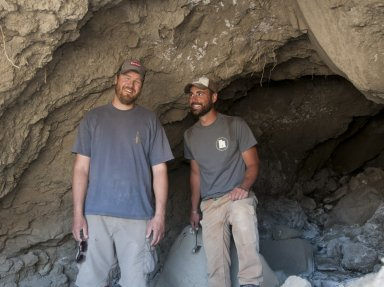 L-R: Dr. Ian Miller and Dr. Joseph Sertich share a joke as they pose at the mouth of a cave they are about to explore.