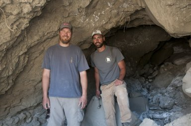L-R: Dr. Ian Miller and Dr. Joseph Sertich pose at the mouth of a cave they are about to explore.
