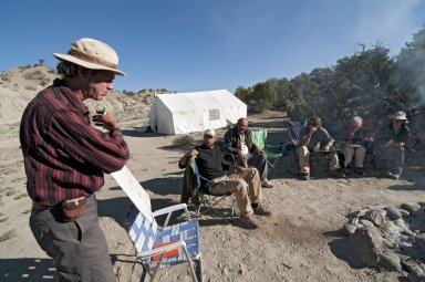 Dr. Bob Raynolds, DMNS Research Associate, conducts a morning briefing around the camp fire.