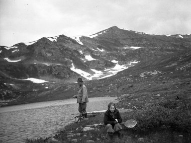 Unidentified fisherman and young girl