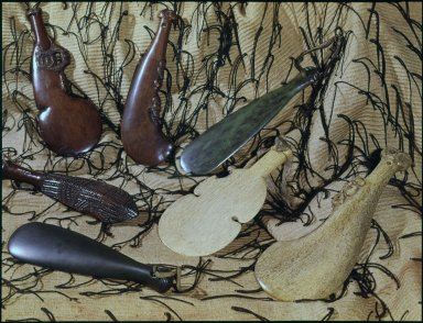 Wooden, greenstone and whalebone clubs.