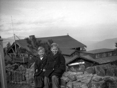 Two unidentified boys sit on a wall overlooking the museum complex at Buffalo Bill's Grave on Lookout Mountain near Denver, Colorado.