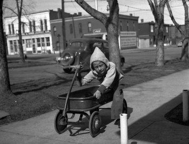 Boy with a Toy Wagon