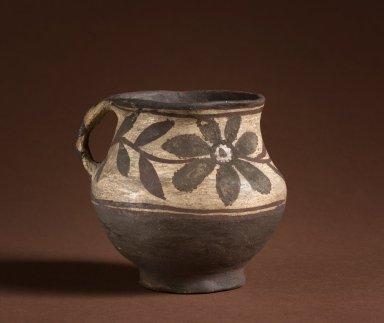 Keresan Acoma Ceramic Pitcher with a floral design.