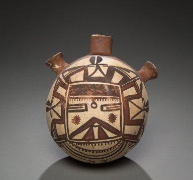 Hopi pottery canteen with a polychrome Kachina design.