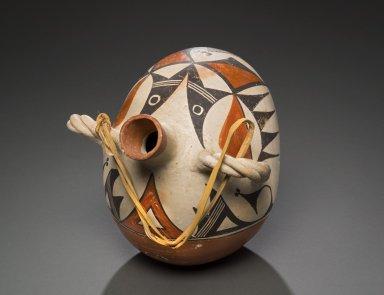 Acoma polychrome pottery canteen.
